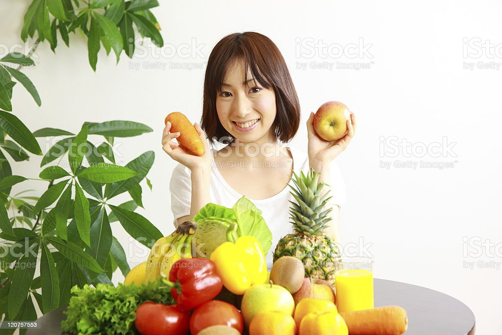 Woman with Fruits and vegetables royalty-free stock photo
