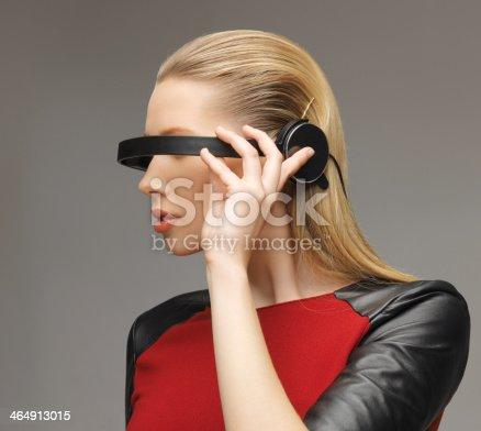 917307226 istock photo woman with futuristic glasses 464913015