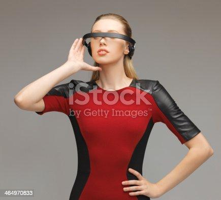 917307226 istock photo woman with futuristic glasses 464970833