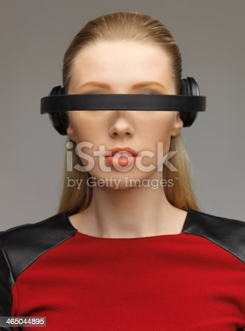 917307226 istock photo woman with futuristic glasses 465044895