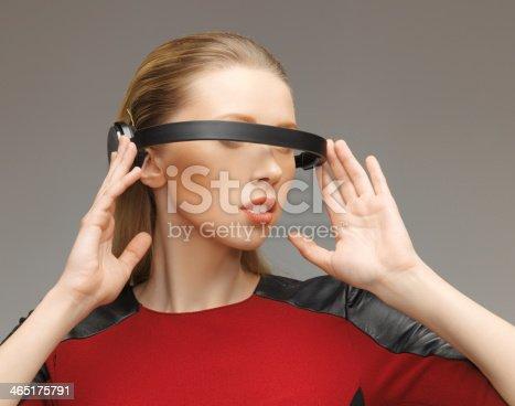 917307226 istock photo woman with futuristic glasses 465175791