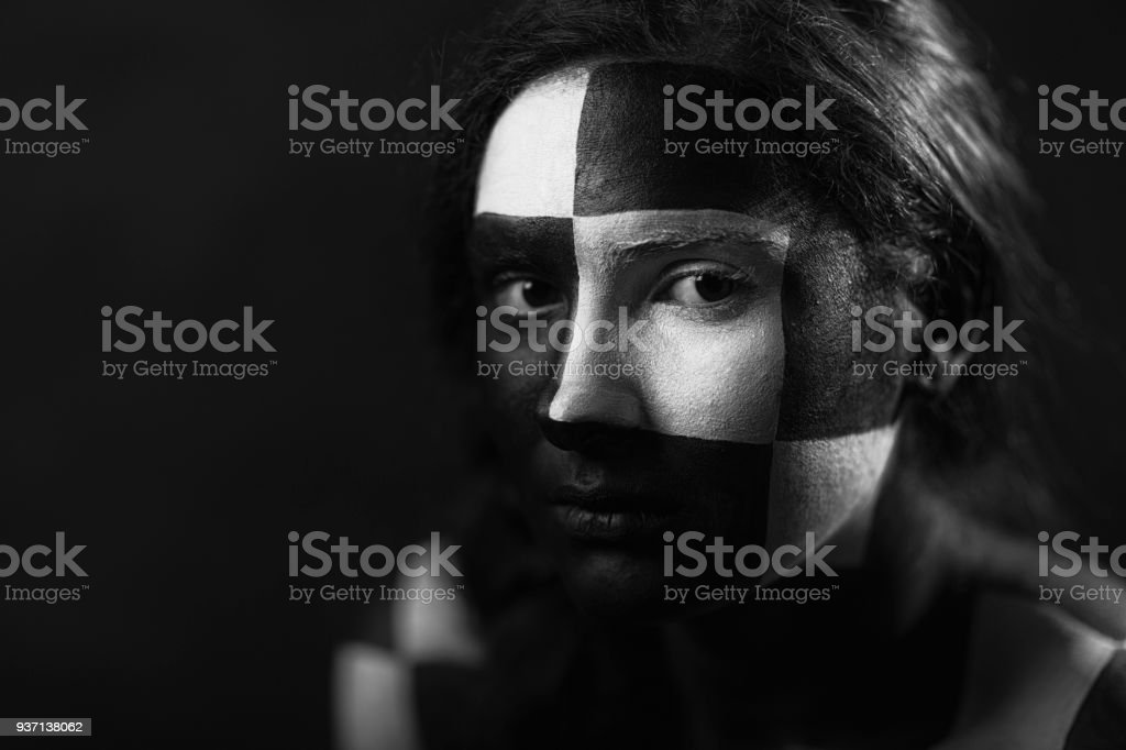 Woman with geometric face painting stock photo