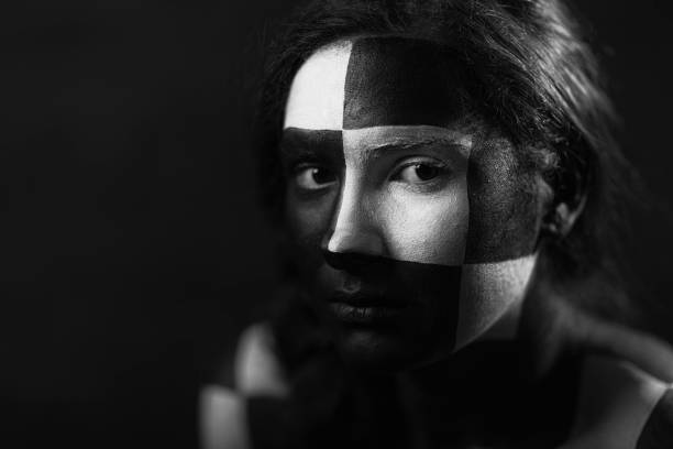 Woman with geometric face painting Young woman with geometric black and white face painting. body paint stock pictures, royalty-free photos & images