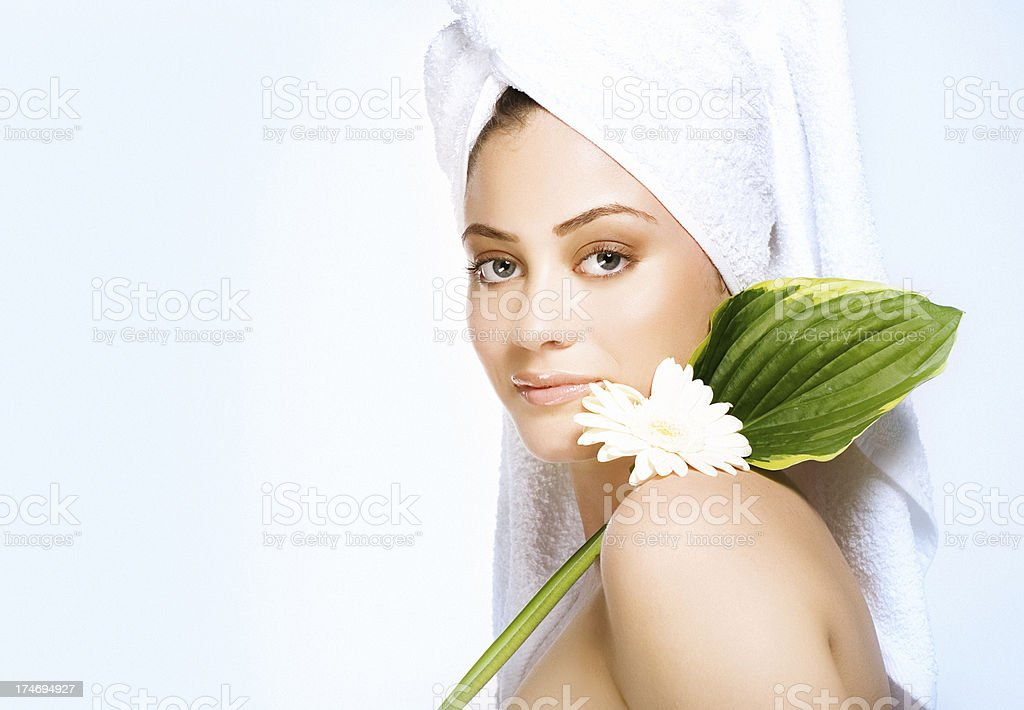 woman with gerbera on her shoulders royalty-free stock photo