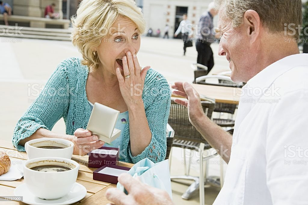 Woman with gift from husband royalty-free stock photo