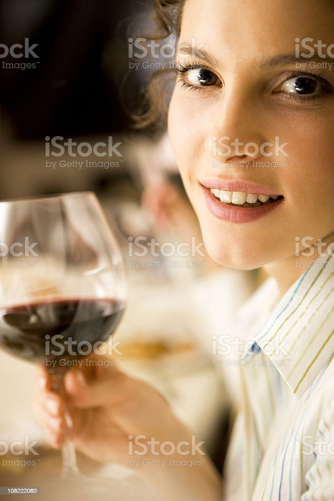 Woman with glass of wine royalty-free stock photo
