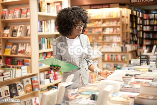 istock A woman with glasses working in a bookstore 467559030
