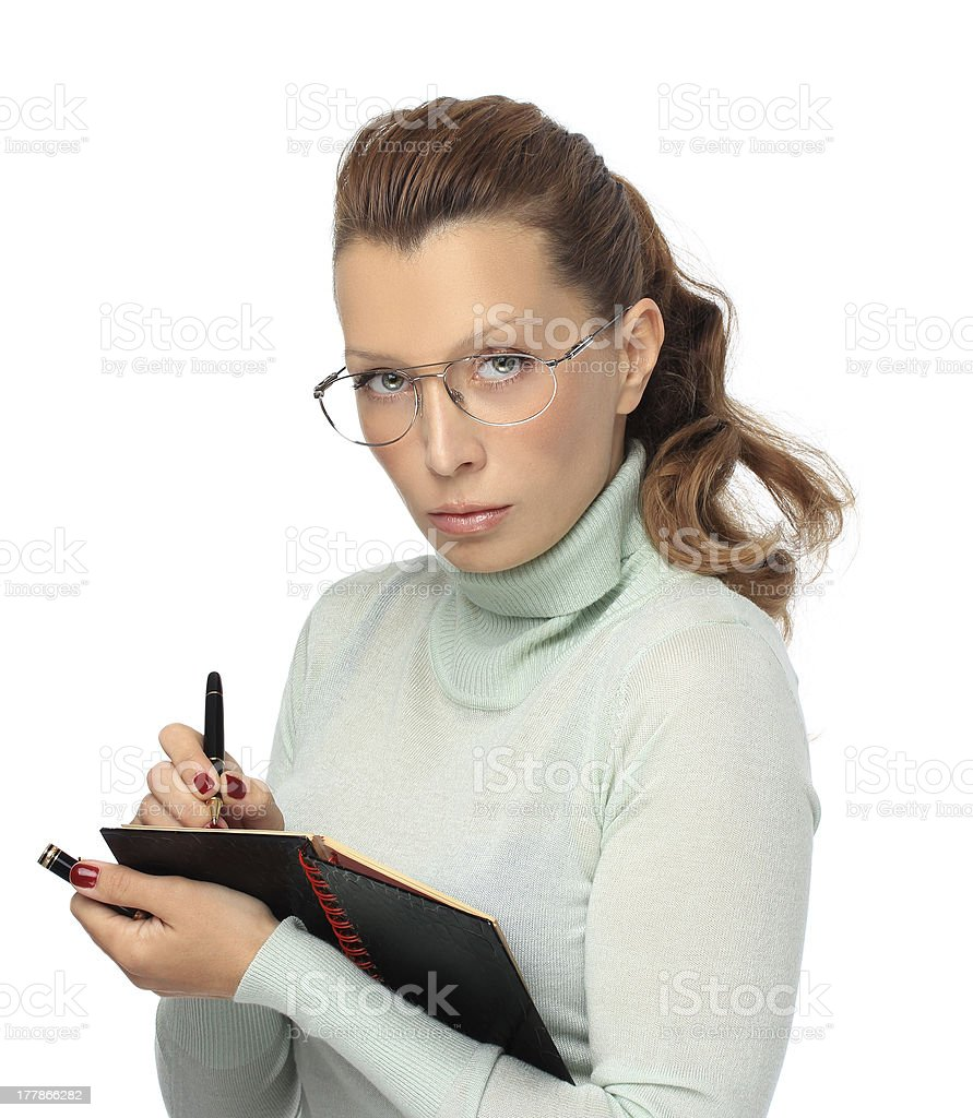 Woman  with glasses writing in her notebook royalty-free stock photo