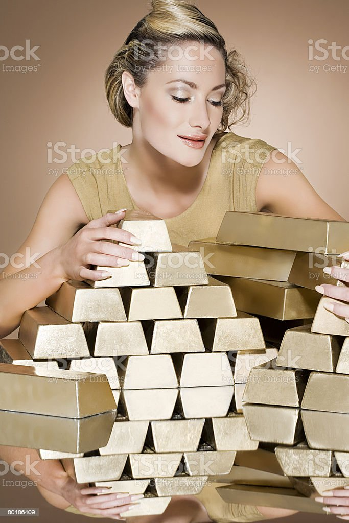 Woman with gold bars 免版稅 stock photo