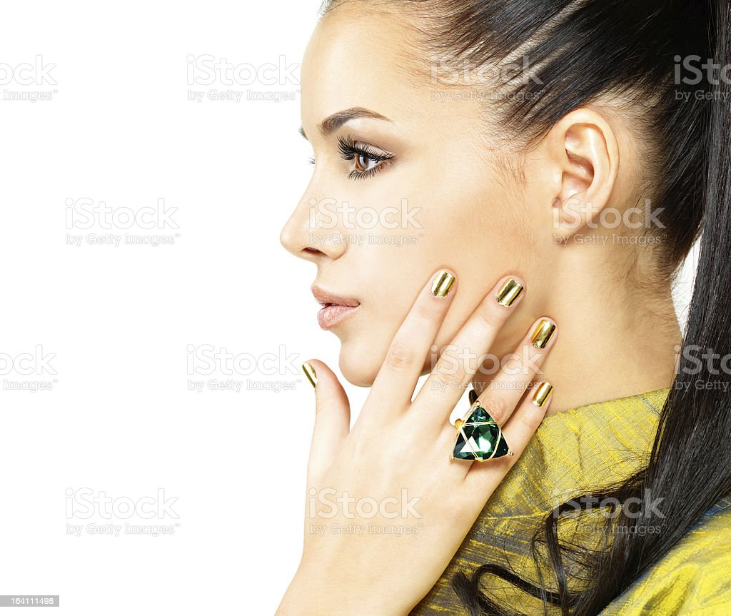 woman with golden nails and precious stone emerald royalty-free stock photo
