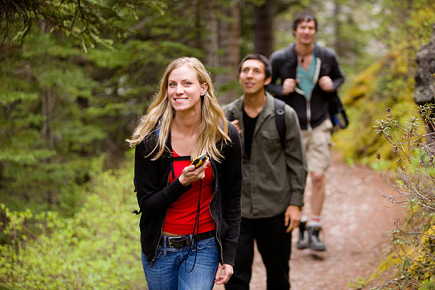 Woman with GPS in Forest stock photo