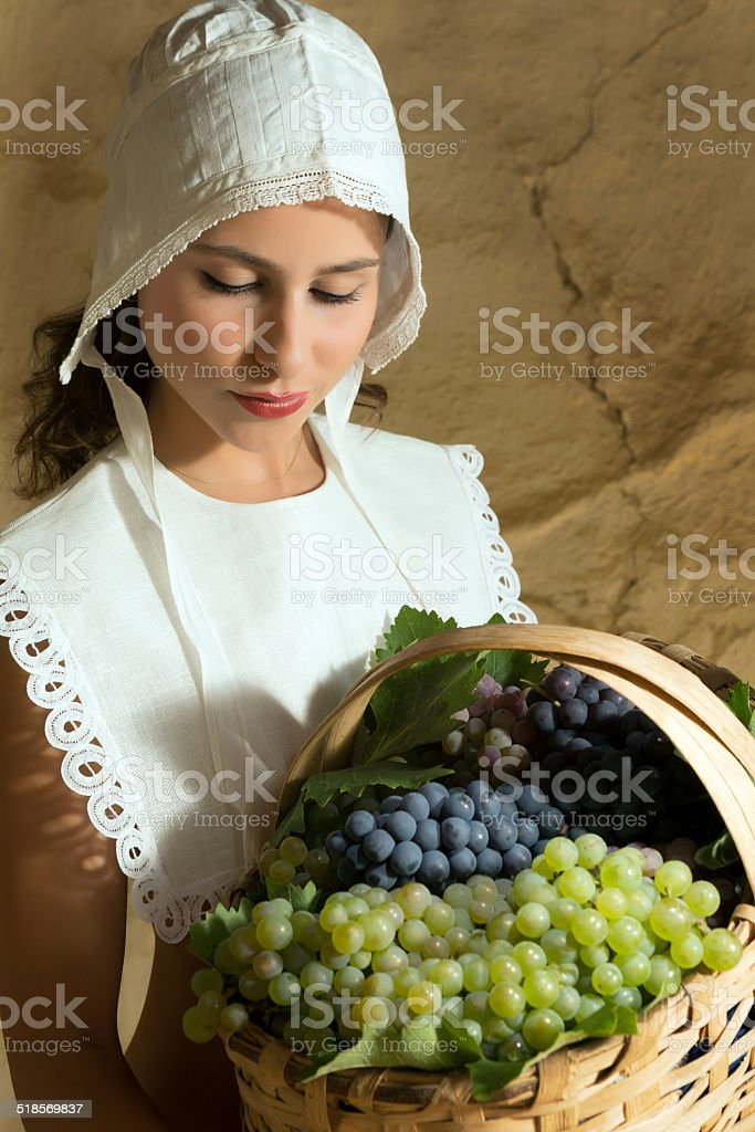 Woman with grapes in basket stock photo