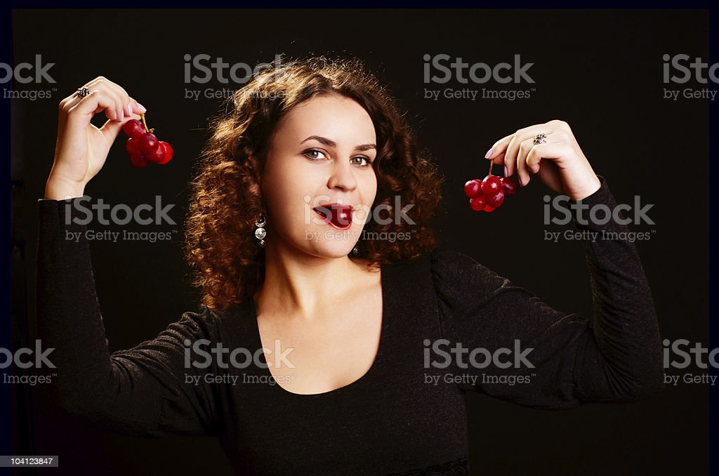 Woman with grapes. royalty-free stock photo
