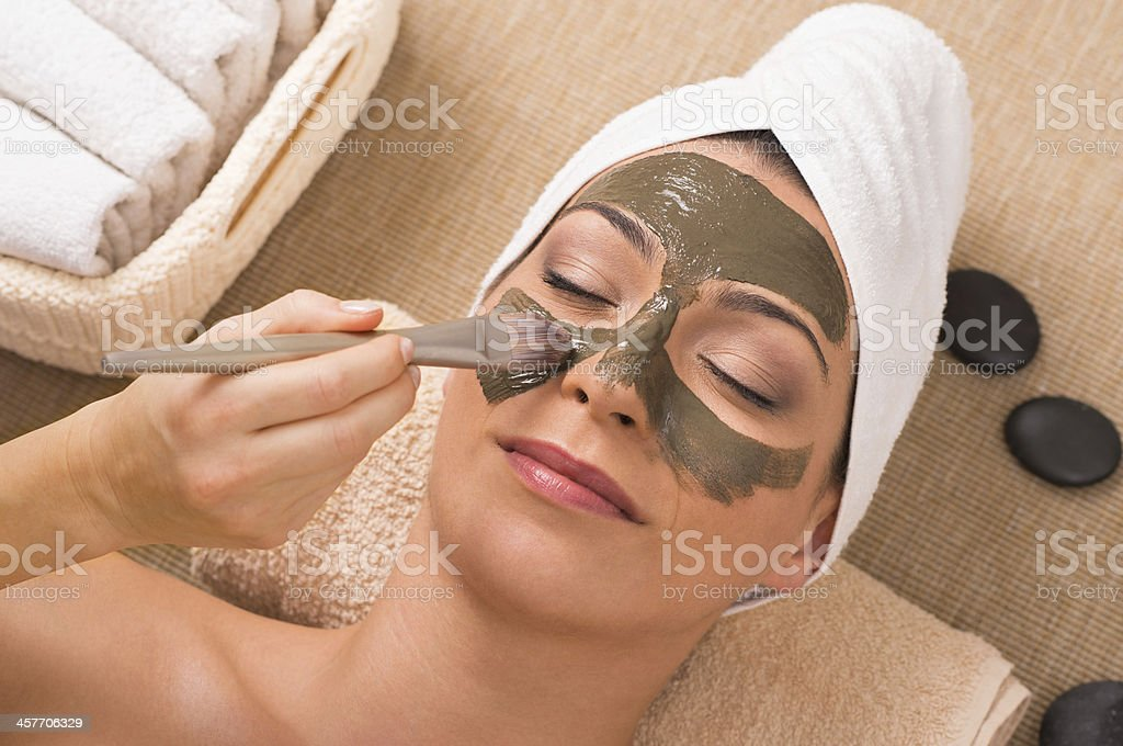 Woman With Green Clay Mask At Spa stock photo