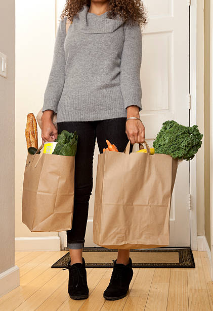 woman with grocery bags stock photo