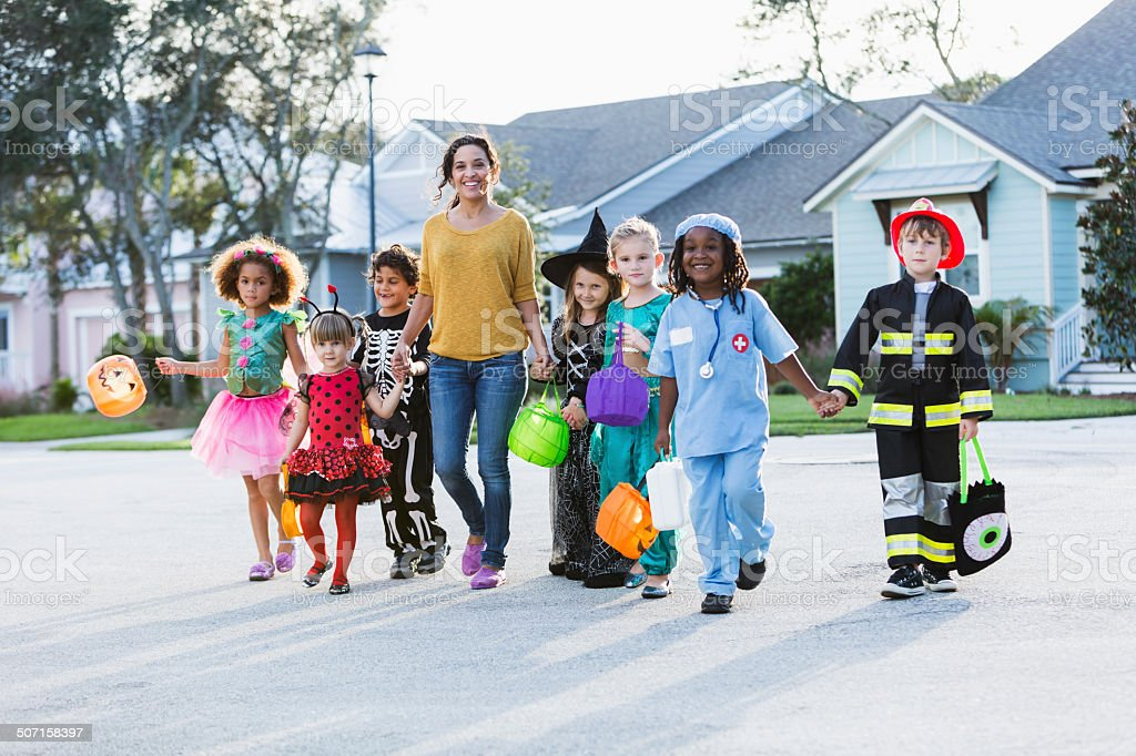 Woman with group of children on halloween stock photo