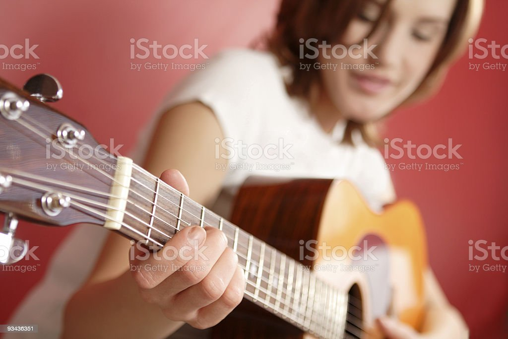 Woman with guitar royalty-free stock photo