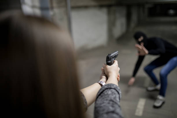 Woman with gun for self defense stock photo