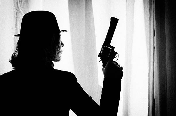 woman with gun.retro look.black and white. - female spy stock photos and pictures