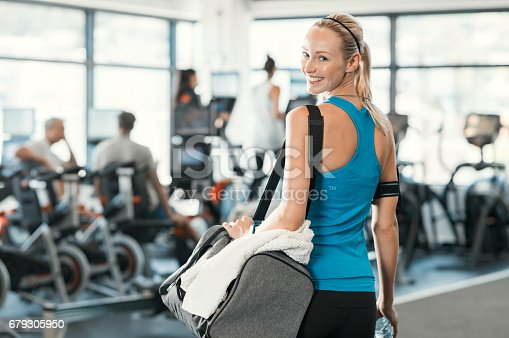 istock Woman with gym bag 679305950