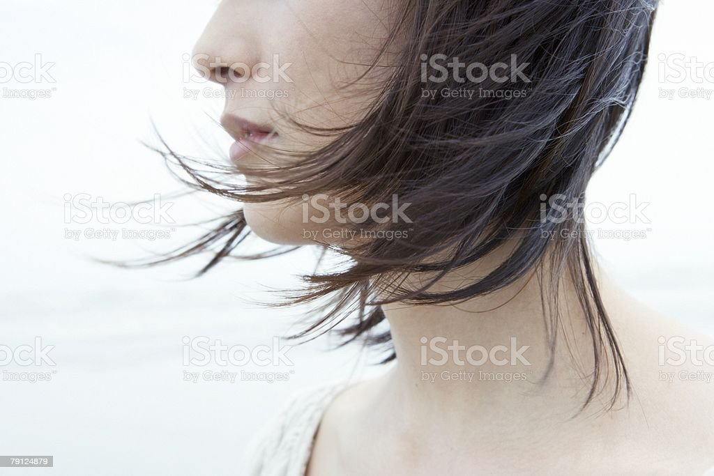 Woman with hair blowing in wind 免版稅 stock photo