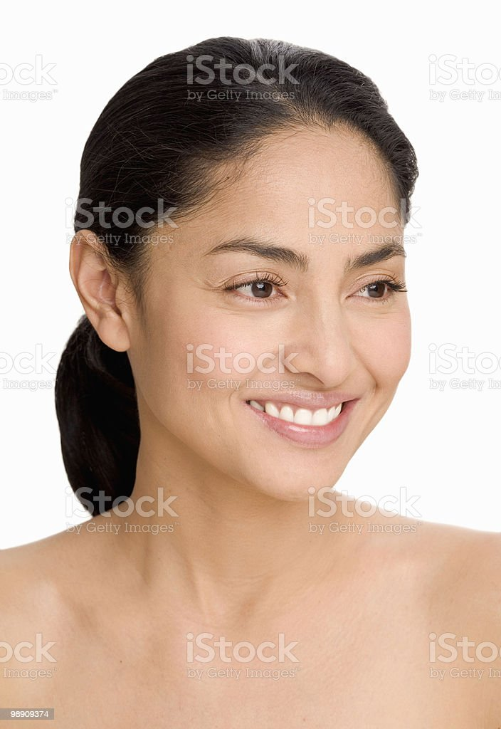Woman with hair pulled back, smiling foto stock royalty-free