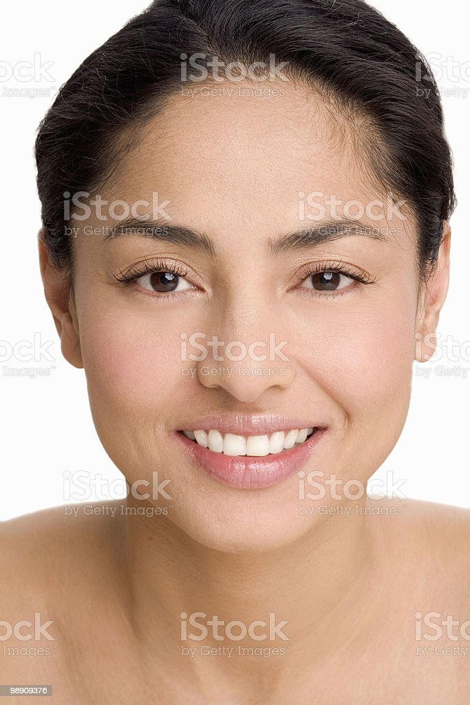 Woman with hair pulled back, smiling foto de stock libre de derechos