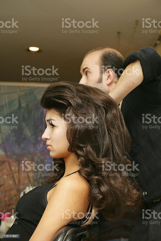 Woman with hair stylist royalty-free stock photo
