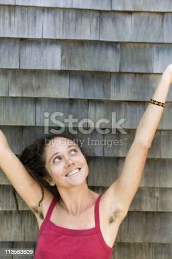 istock woman with hairy armpits 113583609