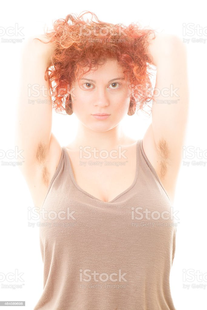 Woman with Hairy Armpits stock photo