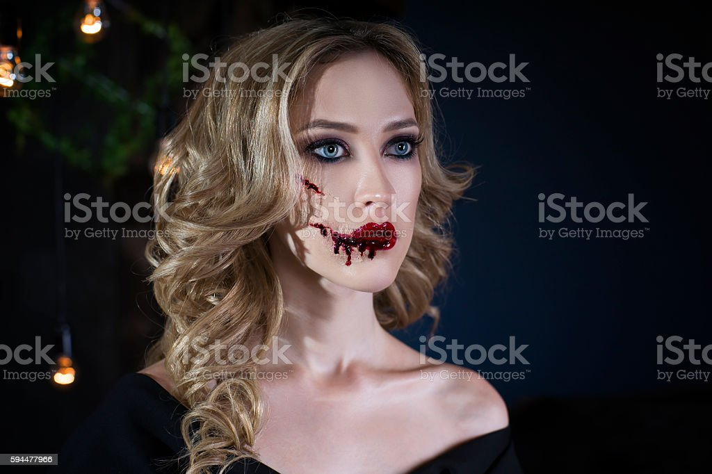 Woman with halloween make up and bloody face art stock photo