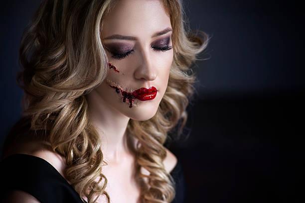 woman with halloween make up and bloody face art - vampir schminken frau stock-fotos und bilder