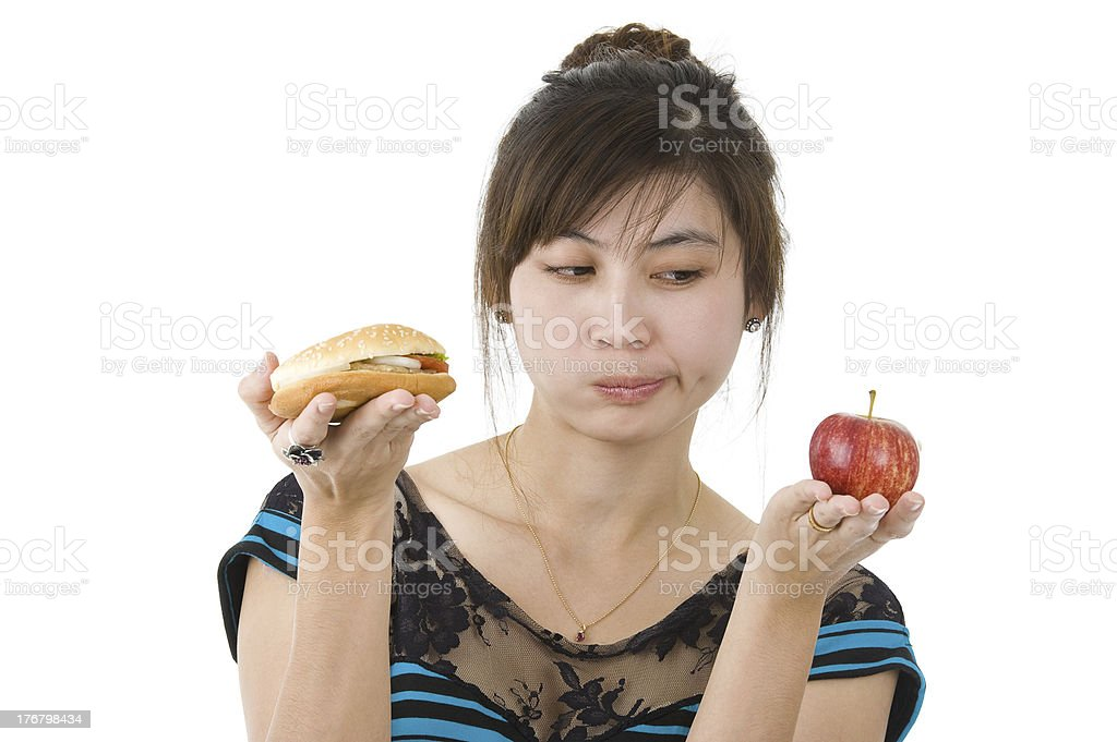 woman with hamburger and apple royalty-free stock photo