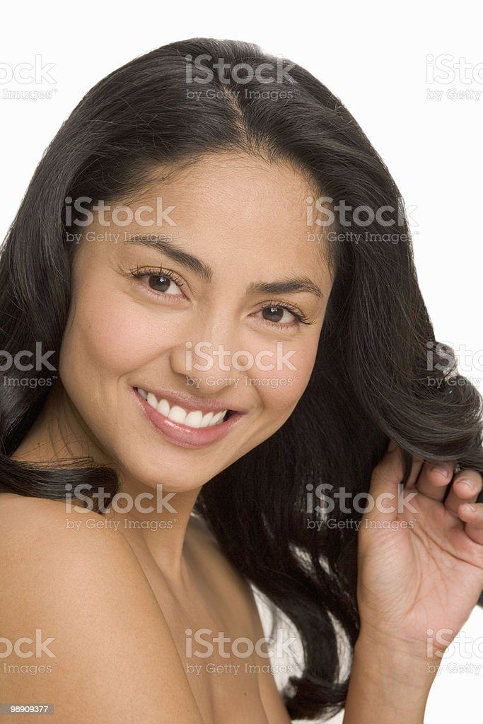 Woman with hand in hair, smiling royalty-free 스톡 사진