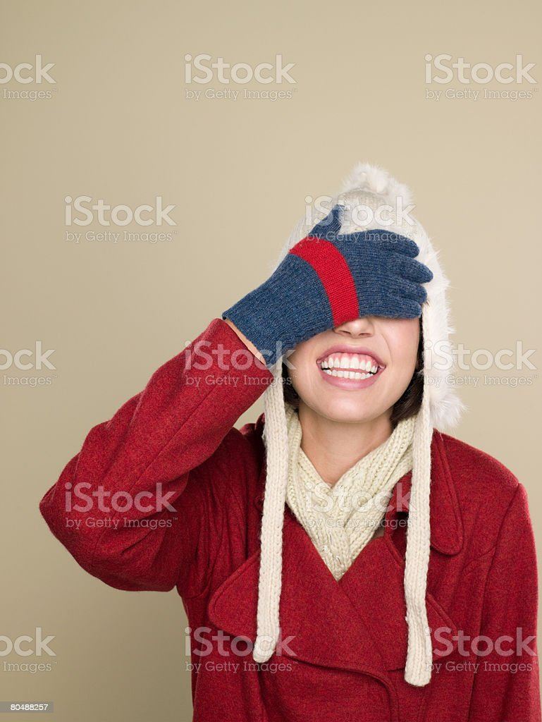 Woman with hand over eyes 免版稅 stock photo