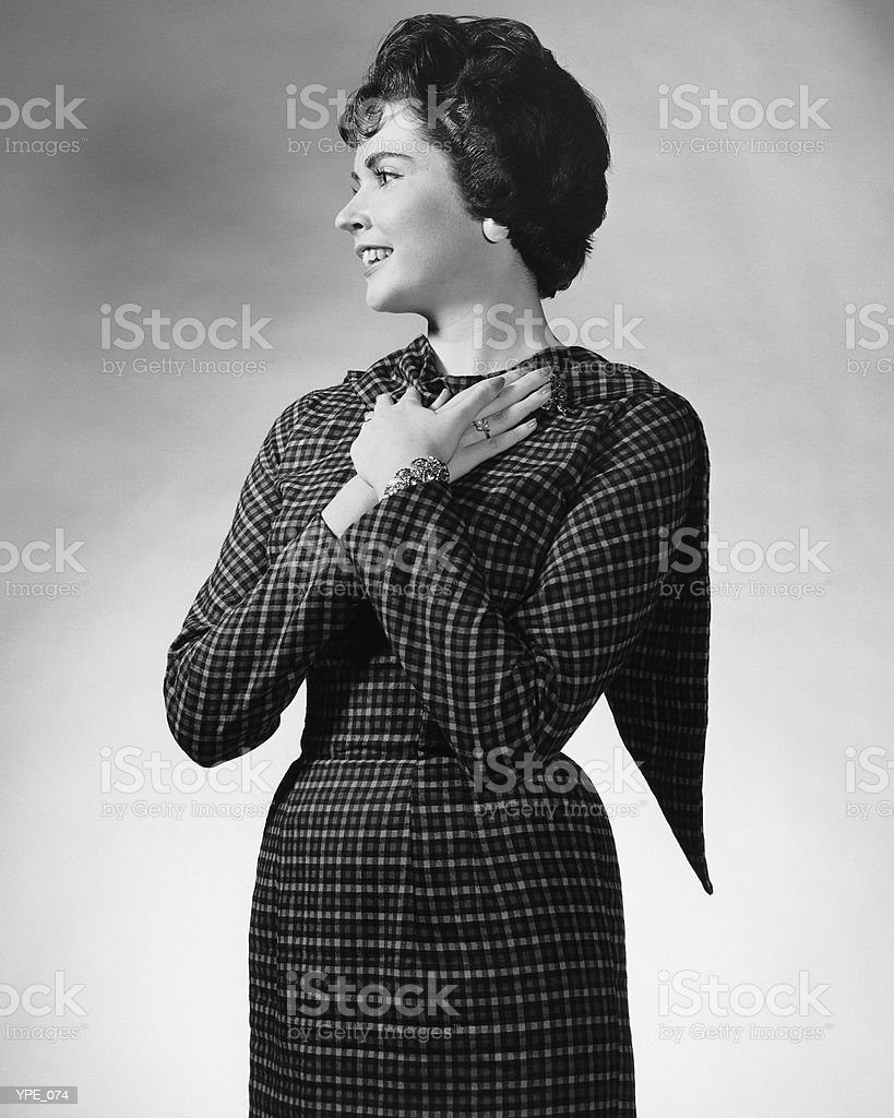 Woman with hands clasped to chest royalty-free stock photo