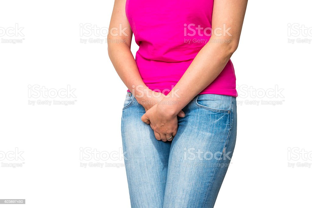 Woman with hands holding her crotch - incontinence concept stock photo