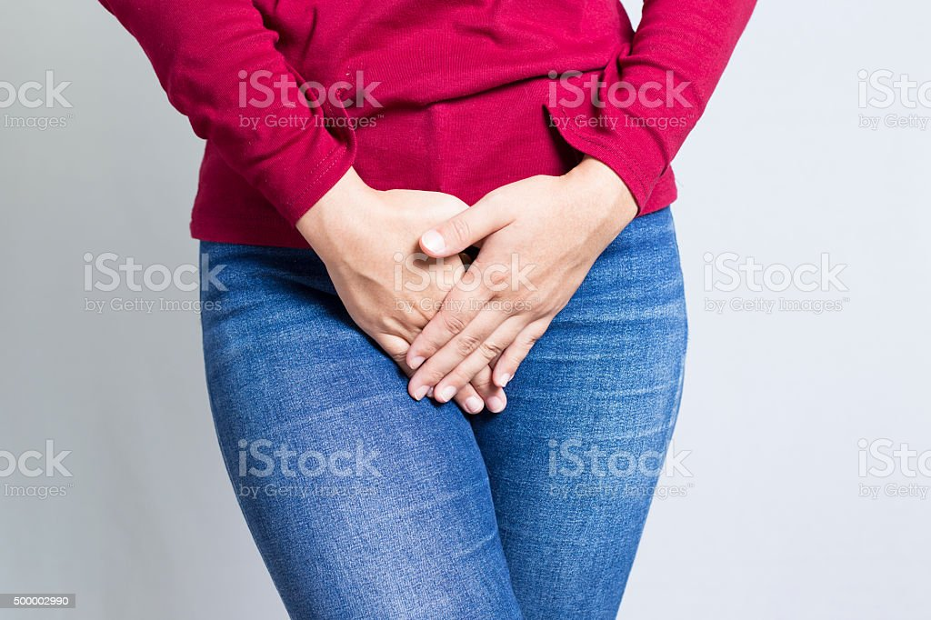 Woman with Hands Holding her Crotch stock photo