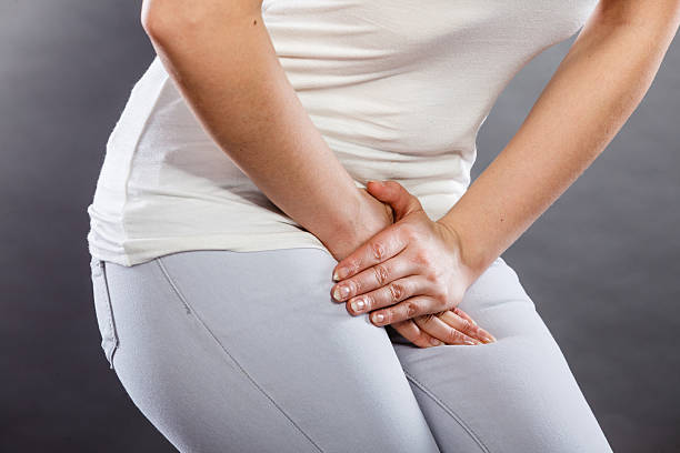 woman with hands holding her crotch - vagina stock photos and pictures