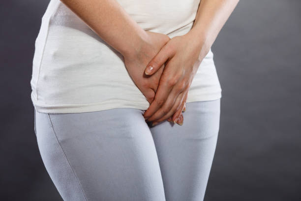 woman with hands holding her crotch Closeup young sick woman with hands holding pressing her crotch lower abdomen. Medical or gynecological problems, healthcare concept sexually transmitted disease stock pictures, royalty-free photos & images