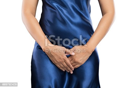 859986274istockphoto Woman with hands holding pressing her crotch lower abdomen. Medical or gynecological problems, healthcare concept 669792428