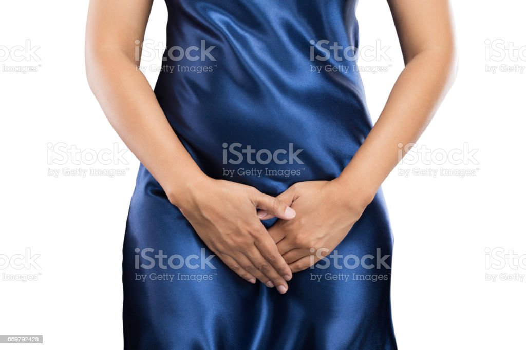 Woman with hands holding pressing her crotch lower abdomen. Medical or gynecological problems, healthcare concept stock photo