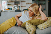 istock Woman with hands on stomach suffering from pain stock photo 1250173635