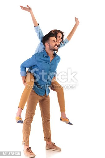 istock woman with hands up on the back of her boyfriend 854378408