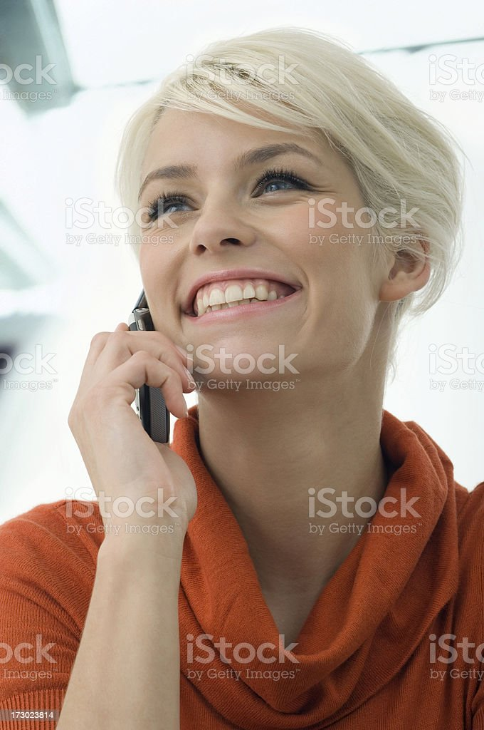 Young woman with handy is happy