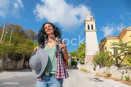 Woman walking on road and enjoying vacations.