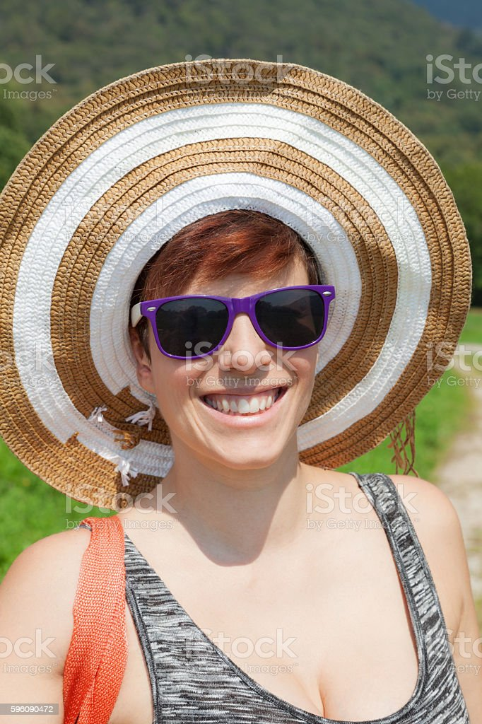 Woman with hat and sunglasses royalty-free stock photo