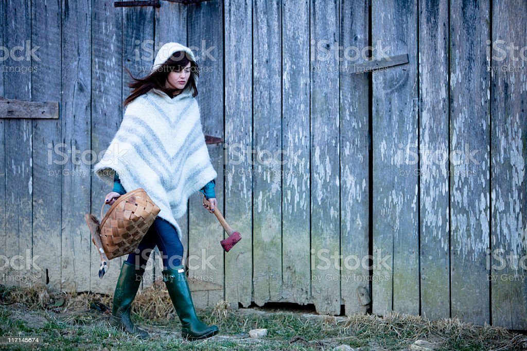 Woman with hatchet and picnic basket royalty-free stock photo