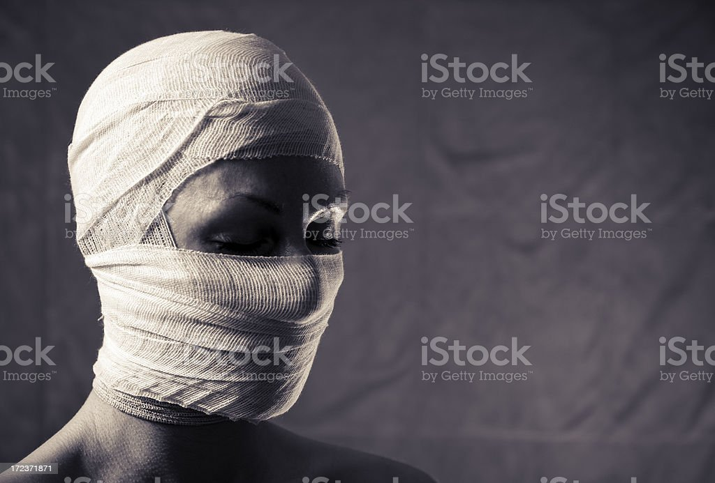 Woman with head bandage