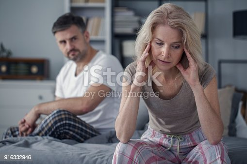 istock Woman with headache and husband 916332946
